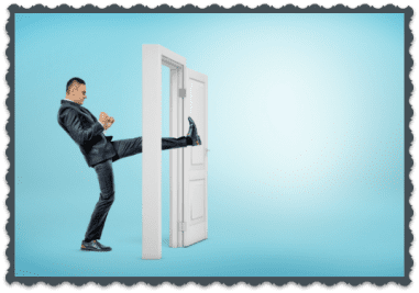 FAQ Man Kicking through Doorway