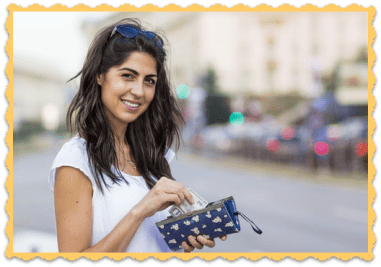 FAQ Young Woman Saves Money Hand in Pocketbook pulling out money