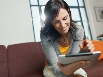 About Savvy Perks, Woman on Tablet