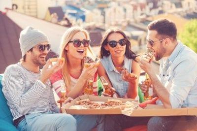 Table of Friends sharing Restaurant Deals