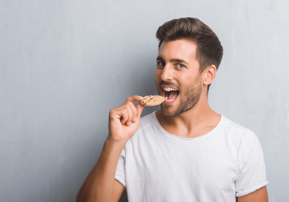 Cookies By Design Man Eating Cookie